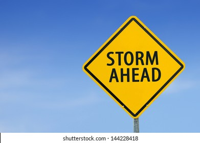 """STORM AHEAD"" traffic sign with blue sky"