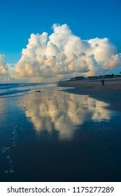 Storm at beach morning sunrise cumulus rain cloud