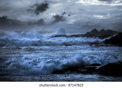 Storm in a beach in the Portuguese north coast with interesting waves; enhanced sky