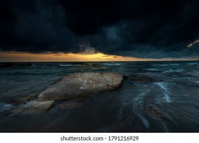 storm before sunset in the sea