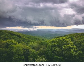 Storm brewing over green hills and mountain range in North Carolina