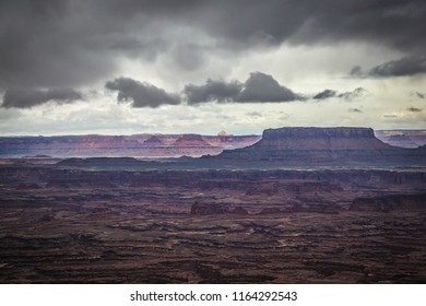 A storm is brewing over the stark desert landscape of the Needles Overlook in the Canyon Rims Recreational Area outside of Monticello, Utah