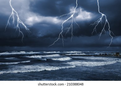 Storm by the sea. Thunder sky. Rain. Heavy dark clouds with sparkling  lightning