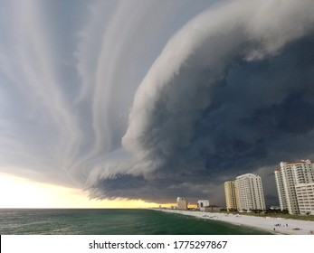 Storm cloud formation over the beach in Pensacola, Florida. Beautiful sunset with storm on the pier. Florida hurricane season, thunderstorm clouds.