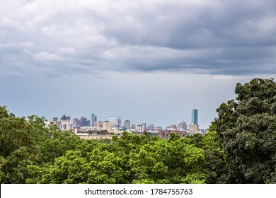 Storm clouds above city skyline in the distance.