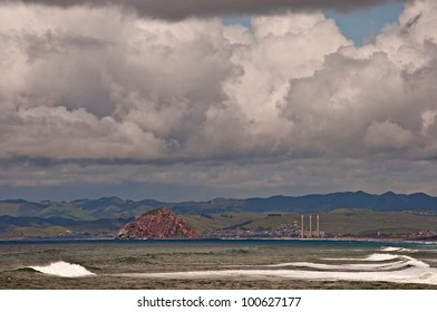 Storm clouds brew over Morro Rock and the central California coastline.