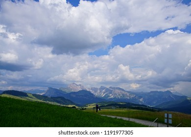 Storm clouds building over Alpine alm meadows in the Dolomites Alps, Italy