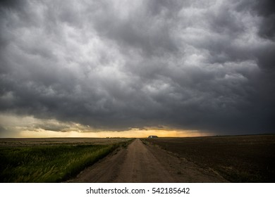 Storm clouds with a dirt road in rural America