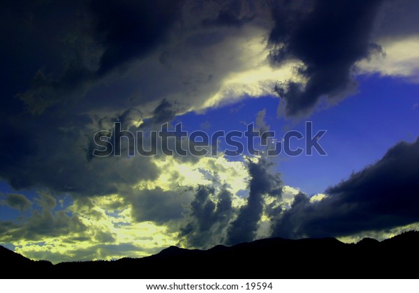 Storm clouds gather at sunset over the Rocky Mountains in Southern Colorado.