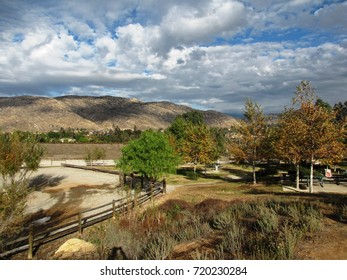 Storm clouds gathering above a rural picnic area, California