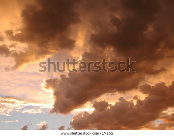 Storm clouds had gathered over Wallis Lake in NSW Australia. Lit by the setting sun they make a spectacular display