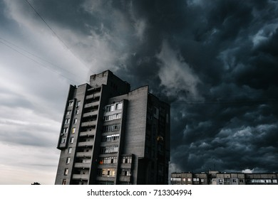 Storm clouds, a hurricane is coming. Beautiful storm sky with clouds over the city, apocalypse like