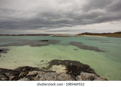 Storm Clouds over a beautiful green sea at Traigh Beach at Arisaig in Lochaber in the Scottish Highlands.