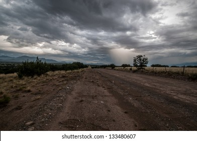 Storm clouds over a dirt road in New Mexico.