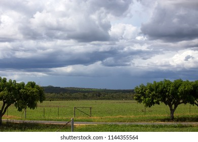 Storm clouds over farm field near Petford on the Atherton Tablelands in Queensland, Australia