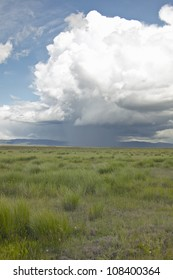 Storm clouds over grasslands and mountains at Red Rock Lake in Centennial Valley, near Lakeview, Montana