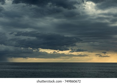 Storm clouds over sea before sunset