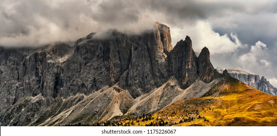 Storm clouds over the summit of Sella Group in a autumn afternoon, rainy season - Trentino-Alto Adige, Italy