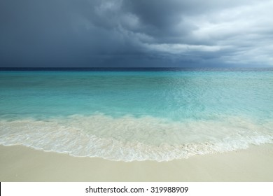 Storm clouds over a tropical beach on Little Curacao, Netherlands Antilles.