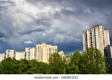 Storm clouds and rainbow over town. Belgrade, Serbia.