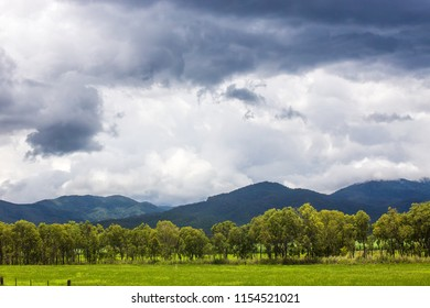 Storm clouds and rainforest covered hills on the Atherton Tablelands in Queensland, Australia