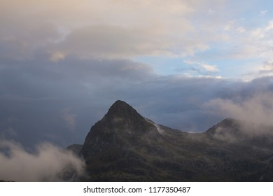 Storm clouds and rocky peaks in the Dolomite Mountains, Italy, at sunset
