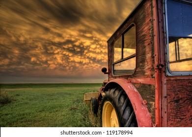 Storm Clouds Saskatchewan with antique vintage tractor