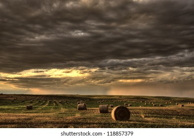 Storm Clouds Saskatchewan hay bales in Canada