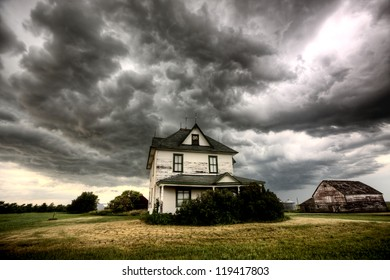 Storm Clouds Saskatchewan old farm and darkened skies