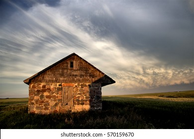 Storm Clouds Saskatchewan Prairie scene Stone house