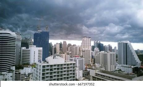 Storm cloudy over the city.Bangkok Thailand. High view building in raining season.