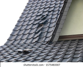 Storm damage - slipped roof tiles after hurricane
