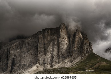 Storm formation over the top of Sella Tower in summer season, danger for mountain climbing