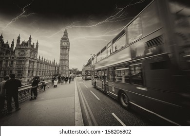 Storm in London with Red Bus crossing Westminster Bridge.