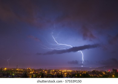 storm at night over the city (thunderbolt)