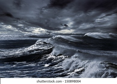 Storm in ocean with big windy waves; Northeast Atlantic Coast; enhanced sky; toned blue