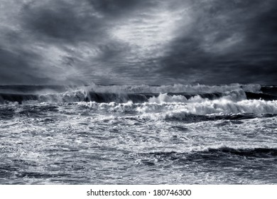 Storm in ocean with windy waves. Northeast Atlantic Coast. Enhanced sky. Toned blue.