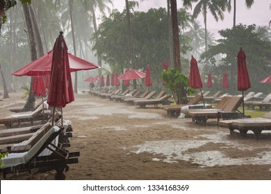storm on the beach, heavy tropical rain in tourist hotel resort, bad weather