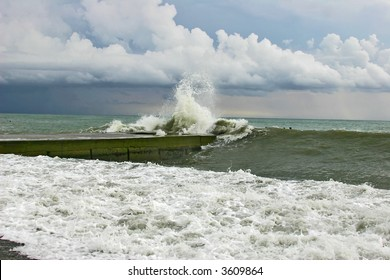 Storm on the sea with high waves under the sky with thunderclouds