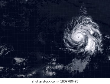 Storm over sea for background, view of tropical hurricane eye from space. Ocean typhoon on satellite photo of Earth. Concept of weather, disaster and warning. Elements of this image furnished by NASA - Shutterstock ID 1809780493