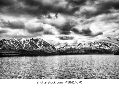 the storm passes over the mountains by a northern lakes in the Yukon