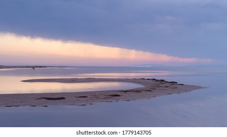 Storm and rain clouds at sunset in the beautiful area of the Ebro Delta. Tarragona province. Catalonia. Spain