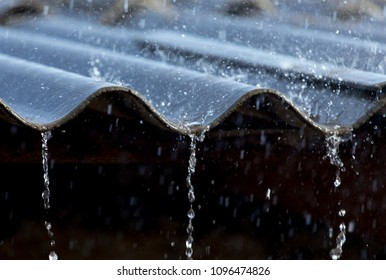 storm rain on the roof of the house