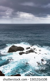 Storm and rain with tall waves hitting the reefs at Playa de Nogales in La Palma, Spain.