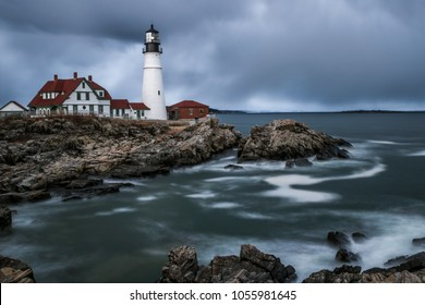 A storm rolls in to meet the Portland Head Lighthouse.