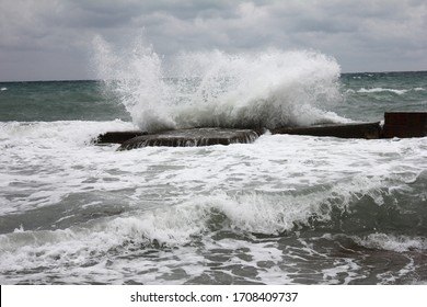 a storm at sea met me with unfriendly waves and a gray sky