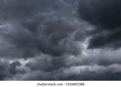 Storm sky with dark grey cumulus clouds background texture, thunderstorm