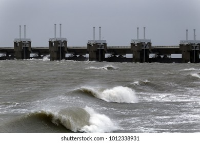 The storm surge barrier Oosterschelde in the Netherlands closed for high tide
