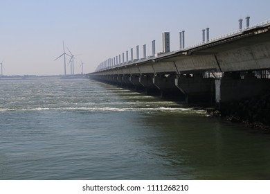 storm surge barriers named Oosterscheldekering to protect part of the Netherlands with a length og 9 kilometers. These are part of the Dutch Deltawerken