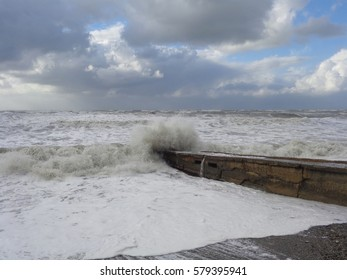 Storm waves at the Black Sea, water splashing on the pier